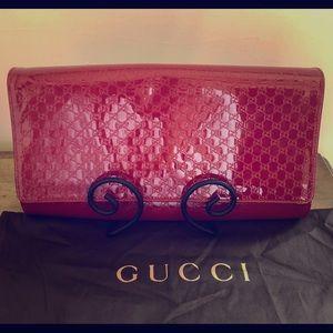 e90243a0e5c6c7 Women's Red Gucci Leather Clutch on Poshmark
